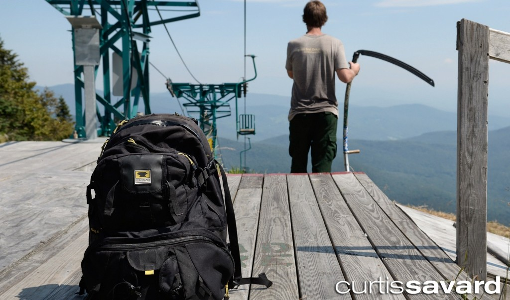 The Mountainsmith Borealis camera backpack sits at the mid-station of Mad River Glen with Curtis Savard in the background