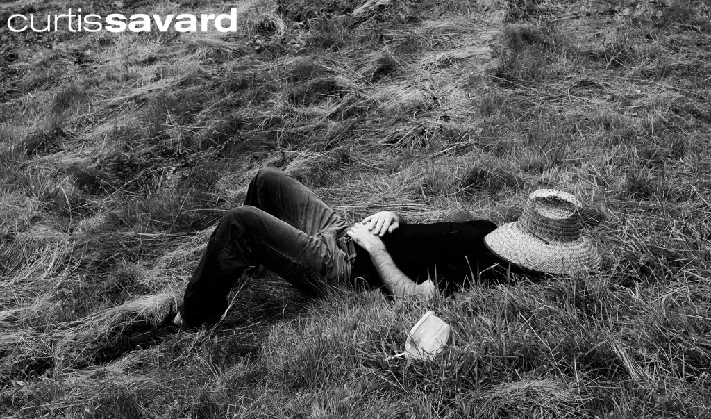 Mow Crew worker from Mad River Glen takes a nap in the grass