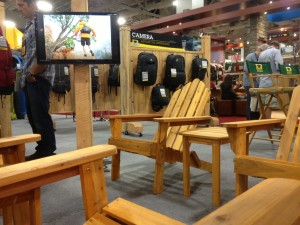 Adirondack chairs in the front of Mountainsmith trade show booth for outdoor retailer