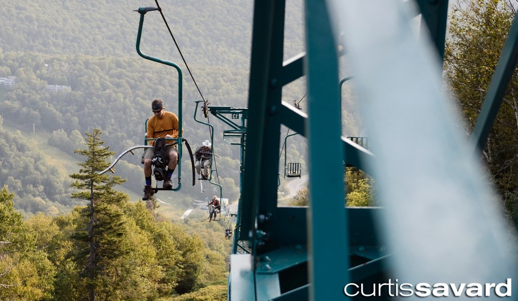 the mow crew rides the single chair to work at mad river glen