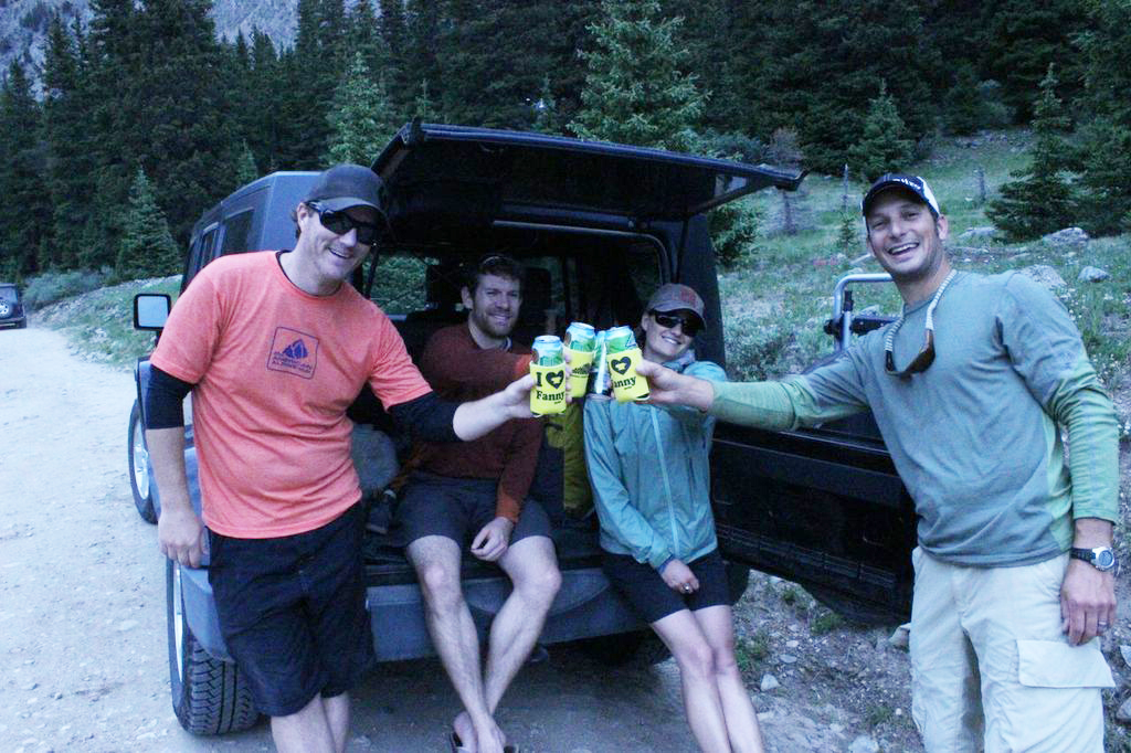 Keegan Young, Erik Lambert, Vickie Hormuth, and Jay Getzel cheers with the new Mountainsmith coozies.