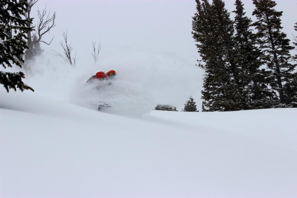Ian Tarbox takes a deep powder turn in Rock Springs sidecountry of Jackson Hole Mountain Resort