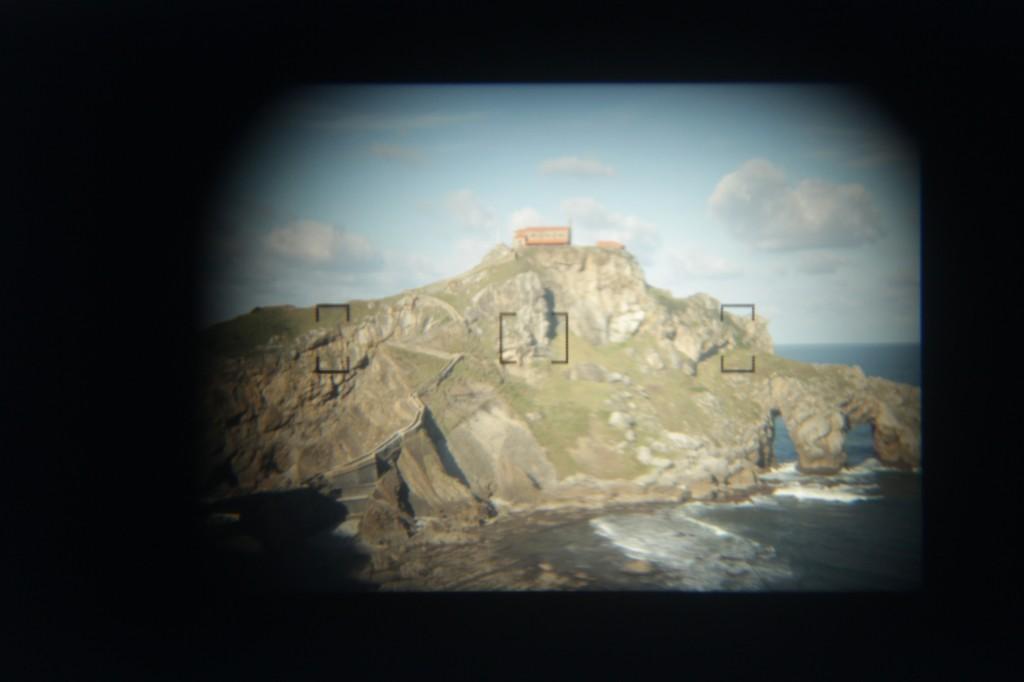 I took this through the viewfinder of a friends' Nikon. The photo was taken in San Juan de Gaztelugatxe.