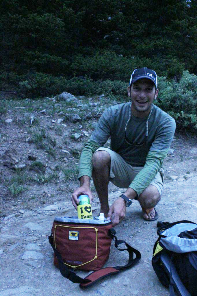 Jay Getzel pulls a beer out of The Sixer cooler from Mountainsmith